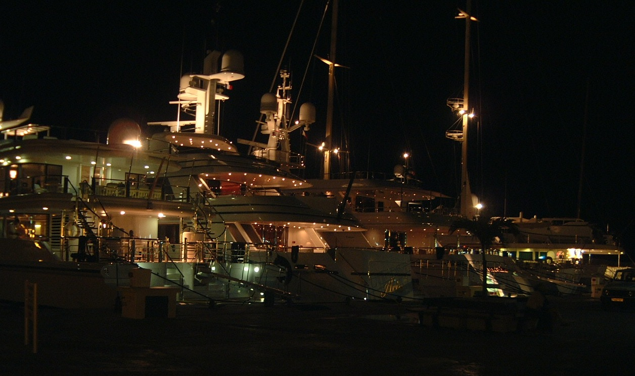 st barth mega yachts docked at night